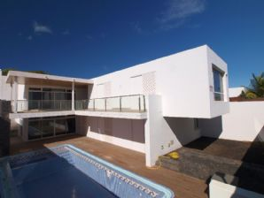 Modern villa with pool and sea views for sale in Puerto Calero