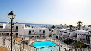 Amazing sea views from this one bedroom apartment for sale in Puerto del Carmen, top floor and communal pool.