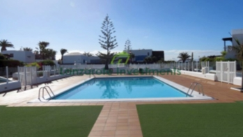 3 Bedroom 2 Bathroom duplex with pool view in Playa Blanca