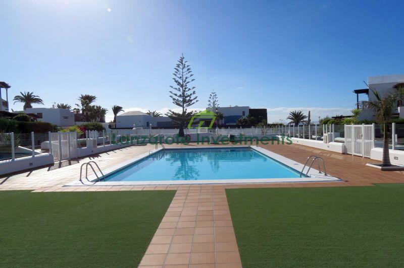 3 Bedroom 2 Bathroom duplex with pool view in Playa Blanca