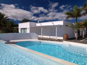 Modern villa with pool, sea views for sale in Puerto Calero