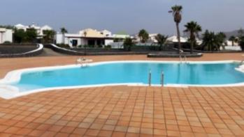 Semi Detached Bungalow with Pool Views in Playa Blanca