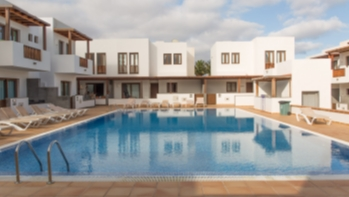 Modern 2 bedroom duplex with large communal pool for sale in Puerto Calero