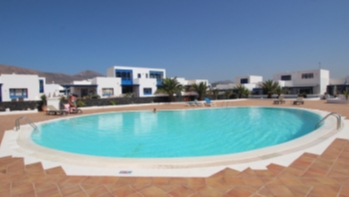 Beautiful three bedroom duplex in a sought after complex in Puerto Calero.