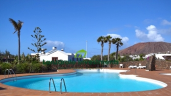 2 Bedroom semi detached villa with communal pool for sale in Playa Blanca