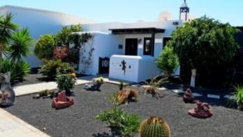2 Bedroom semi detached villa with sea views for sale in Playa Blanca