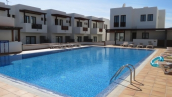 Contemporary 2 bedroom duplex for sale in the exclusive resort of Puerto Calero.