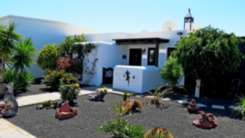 2 Bedroom semi detached villa with sea views for sale in Playa Blanca