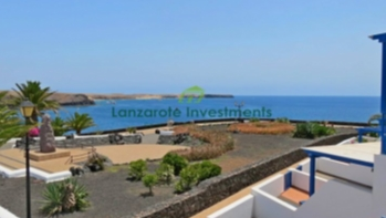Prime Location! Frontline 2 bedroom duplex with extensive sea views in Playa Blanca