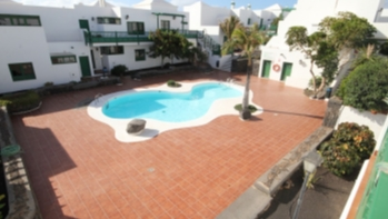 2 bedroom apartment with stunning pool views in Costa Teguise