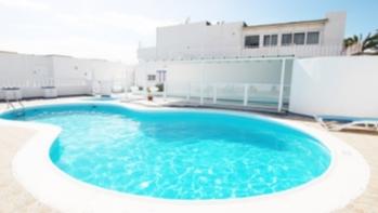 Frontline 2 bedroom duplex overlooking the beach in central Puerto del Carmen