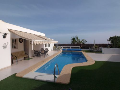 Beautiful villa with pool and sea views in Tias