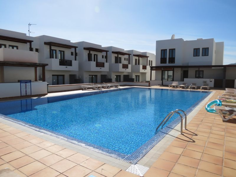 Contemporary 2 bedroom duplex for sale in the exclusive resort of Puerto Calero.