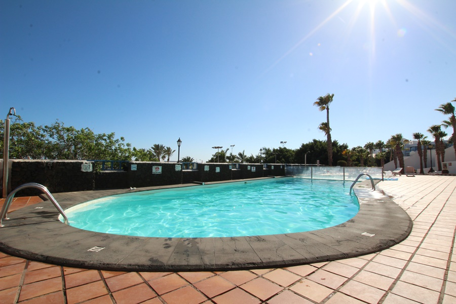 Spacious duplex with communal pool & stunning sea views in Puerto del Carmen