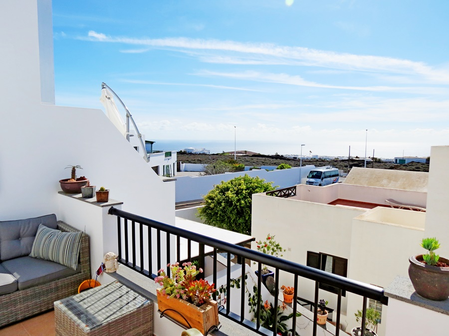 Immaculate 3 bedroom duplex in Tias on gated complex with sea views